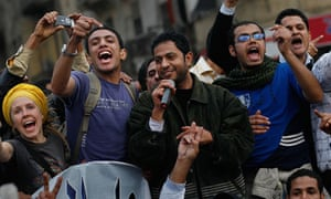 Protesters sing in Tahrir Square in Cairo