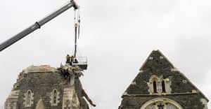 New Zealand Quake: Recovery workers lowered by a crane onto the top of Christchurch Cathedral