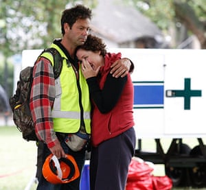 New Zealand Quake: A distraught couple console each other in Christchurch