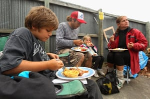 New Zealand Quake: Local residents enjoy a free dinner cooked by a neighbours in Christchurch