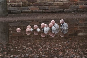 miniature sculpture: Follow the Leader from Isaac Cordal's Cement Eclipses series