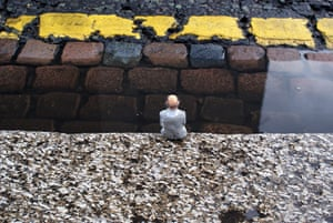 miniature sculpture: Isaac Cordal's Respecting the Yellow Line