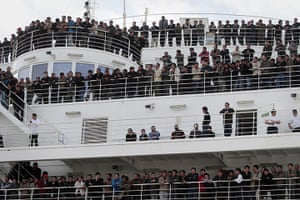 Libya 26 Feb: Chinese citizens, evacuated from Libya, wait aboard a ferry in Valletta