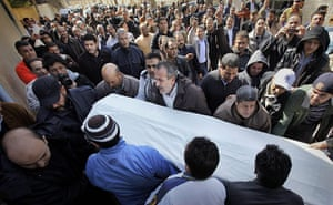Libya 26 Feb: Mourners carry a coffin at a funeral in eastern Tripoli