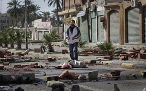 Libya 26 Feb: A man walks through roadblocks made by residents in eastern Tripoli