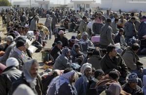 Libya 26 Feb: Egyptians who used to work in Libya wait at the Tunisia-Libya border