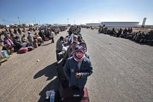 Libya 26 Feb: Egyptians, who used to work in Libya, wait at the Tunisia-Libyan border