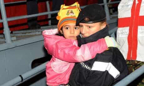 Libya evacuee with soldier