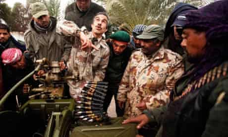Libyan rebel army officer teaches the use of weapons to civilians