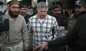 Pakistani security officials escort Raymond Davis to a court in Lahore