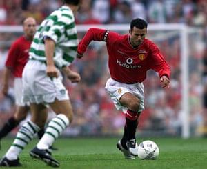 Giggs 20 Years: Giggs of Man Utd goes past Jackie McNamara of Celtic during a testimonial