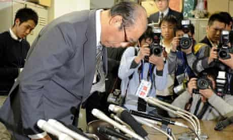 Japan Sumo Association chair, Hanaregoma, bows in apology during a press conference on match-fixing