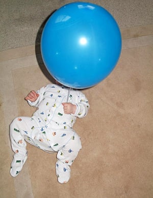 In pictures: play: Baby with balloon
