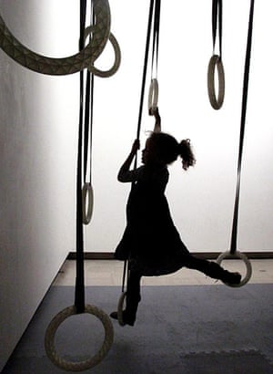 In pictures: play: Girl swinging