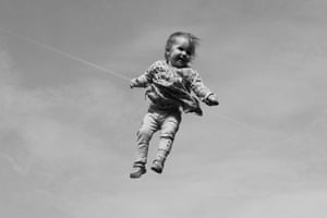 In pictures: play: Girl being thrown in the air