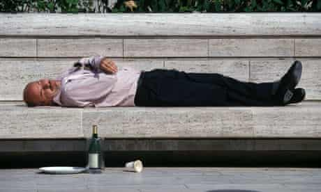Businessman sleeping in Broadgate Circus