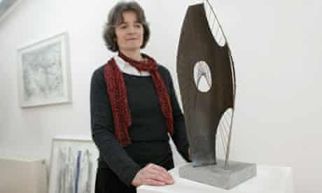 Barbara Hepworth's granddaughter Sophie Bowness with a maquette of Hepworth's Winged Figure 1957