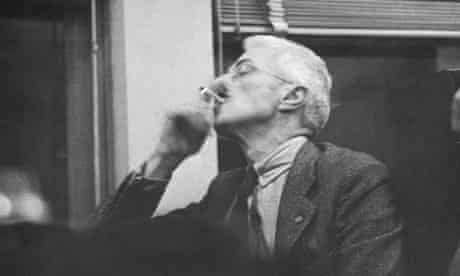 Dashiell Hammett smoking a cigarette