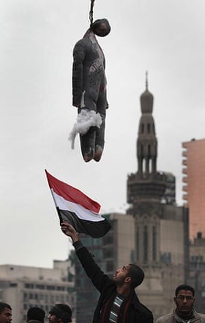 Egypt 05/02: An effigy of Egyptian President Hosni Mubarak hangs in Tahrir Square, Cairo