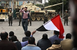 Egypt 05/02: A protester leads fellow demonstrators in chants against Mubarak