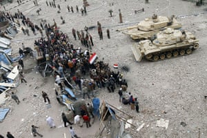 Egypt 05/02: Egyptian anti-government demonstrators face army tanks on Tahrir square