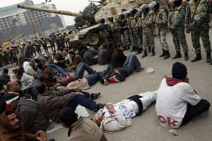 Egypt 05/02: Egyptian anti-government demonstrators face soldiers in Tahrir Square
