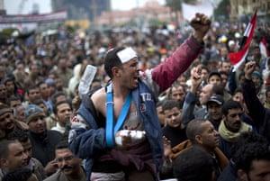 Egypt 05/02: Egyptian anti-Mubarak protesters shout slogans in Tahrir square