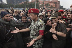 Egypt 05/02: General Hassan el-Roweni is greeted by a anti-Mubarak demonstrators