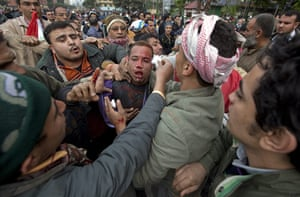 Sean Smith in Egypt: Feb 5: A man believed to be a government police officer is surrounded