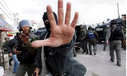 Israeli plain clothes police in East Jerusalem riot over Gaza Strip fighting