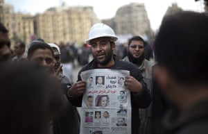 Egypt protests day 13: An anti-Mubarak protester cries as he holds a newspaper