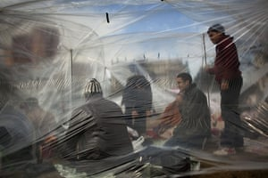 Egypt protests day 13: Anti-Mubarak protesters inside a plastic tent shelter at Tahrir square