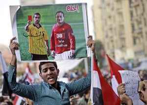Egypt protests day 13: Placard depicting President Mubarak as football player receiving a red card