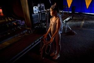 24 hours: Caracas, Venezuela: A young artist with The Chengdu Acrobatic Group waits