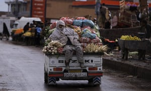 24 hours: Islamabad, Pakistan:A man sits on a vehicle loaded with vegetables