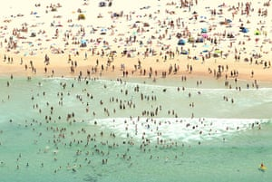 24 hours: Sydney, Australia: Aerial view of crowds escaping the heat at Bondi Beach