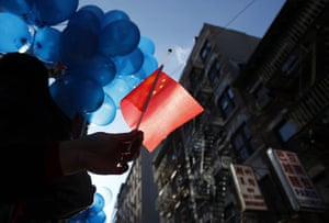 24 hours: New York, USA: A spectator holds a Chinese national flag