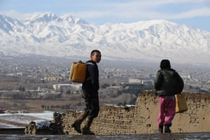 24 hours: Kabul, Afghanistan: Two children carry water