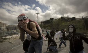 Palestinian youths throw stones in East Jerusalem, 2010