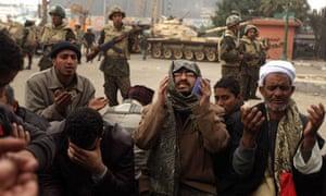 Muslim Brotherhood members pray in Tahrir Square