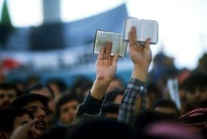 Muslim brotherhood: Korans held aloft by members of Muslim Brotherhood in 1991