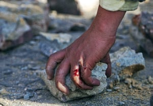 sean smith in egypt:  Anti government demonstrator picks up a stone