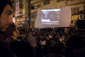 sean smith in egypt: Protestors in Tahrir Square watch President Mubarak's televised speech
