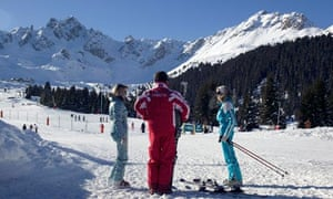 A French ski instructor at work on the slopes of Courchevel in the Alps