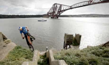 Danny MacAskill riding on Inchgarvie Island in the shadow of the Forth Bridge