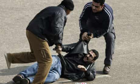 Egyptian plainclothes police officers arrest man