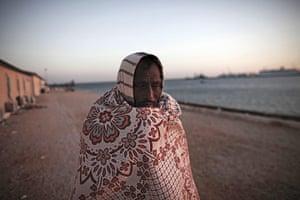 Libya: A Bangladeshi worker waits at the port in Benghazi