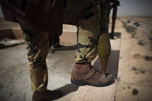 Libya: A revel militiaman with a rocket propelled grenade launcher