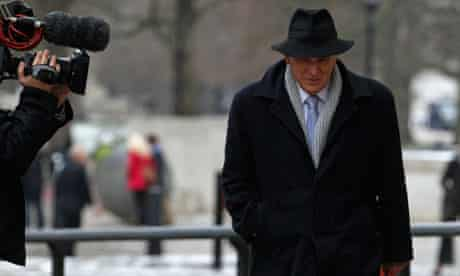 Business secretary Vince Cable is followed by the media in December