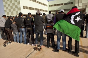 Libya unrest continues: New recruits pray after signing up for the forces